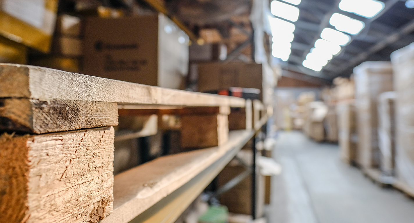 Wooden pallets stacked in a warehouse